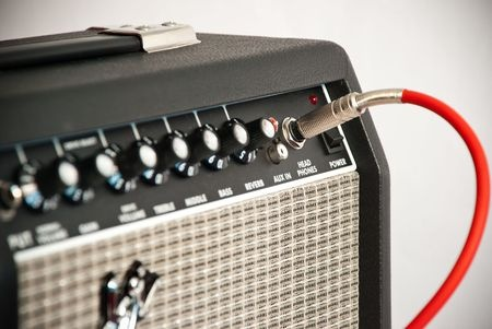 7379470 - black guitar amplifier with red cord